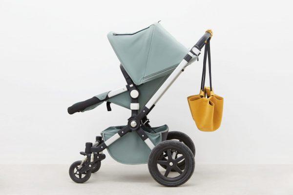 Bolso vira zero mustard con carro bebe